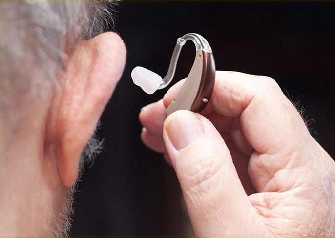 Image of man with hearing aid